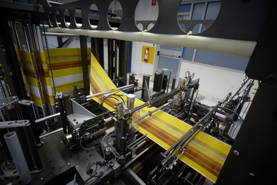 yellow labels rolling through print machine